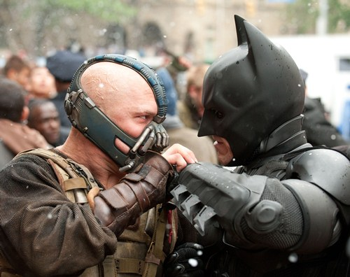 "TOM HARDY as Bane and CHRISTIAN BALE as Batman in Warner Bros. Pictures' and Legendary Pictures' 'THE DARK KNIGHT RISES,"" a Warner Bros. Pictures release."